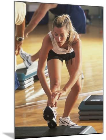 Young Woman Exercising in a Step Aerobics Class--Mounted Photographic Print