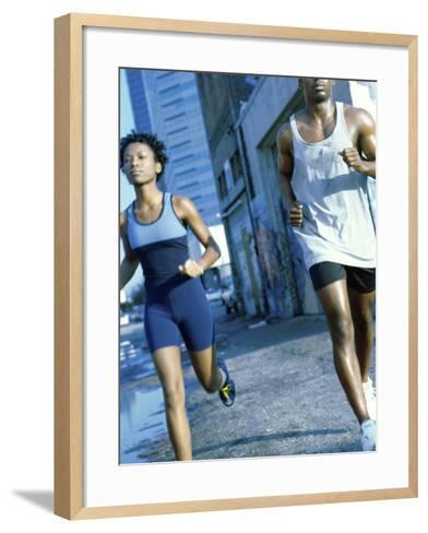 Young Couple Jogging Together--Framed Art Print