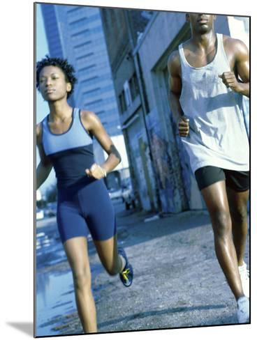 Young Couple Jogging Together--Mounted Photographic Print