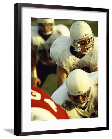 Football Players Playing in a Field--Framed Art Print