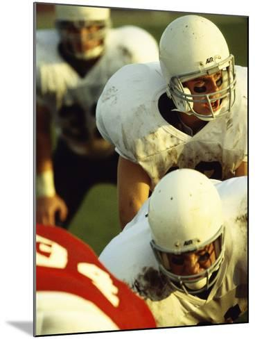 Football Players Playing in a Field--Mounted Photographic Print