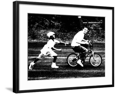 Teen Boy Stealing Younger Boy's Bicycle--Framed Art Print