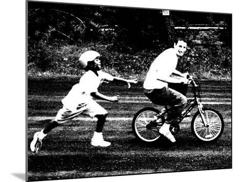 Teen Boy Stealing Younger Boy's Bicycle--Mounted Photographic Print