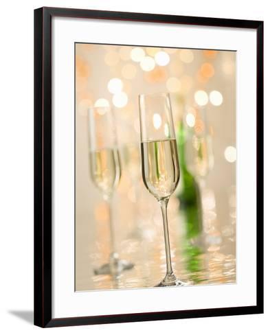 Glasses of Sparkling Wine with Twinkling Lights-Brigitte Protzel-Framed Art Print