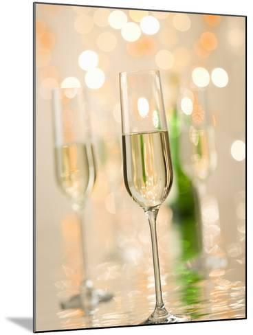 Glasses of Sparkling Wine with Twinkling Lights-Brigitte Protzel-Mounted Photographic Print