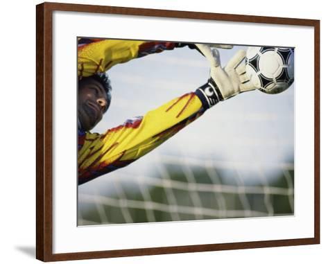 Goalie Attempting to Stop a Soccer Ball--Framed Art Print