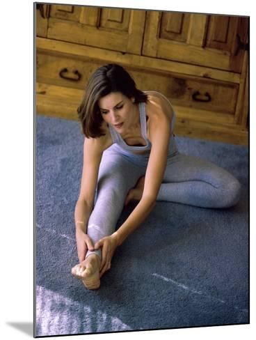 Young Woman Stretching on the Floor--Mounted Photographic Print