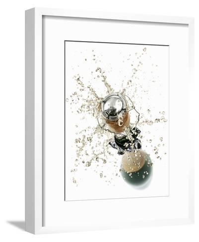 Cork Flying Out of a Sparkling Wine Bottle-Kr?ger & Gross-Framed Art Print