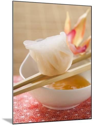 Dim Sum on Chopsticks over Dip (Asia)--Mounted Photographic Print