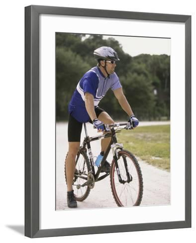 Young Man Sitting on a Bicycle--Framed Art Print