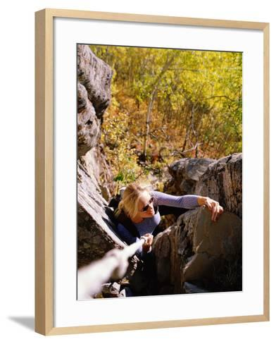 High Angle View of Young Woman Rock Climbing--Framed Art Print