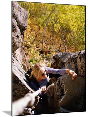 High Angle View of Young Woman Rock Climbing--Mounted Photographic Print