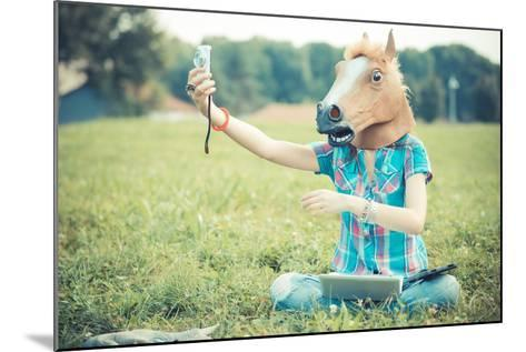 Horse Mask Unreal Hipster Woman Using Technology-Eugenio Marongiu-Mounted Photographic Print