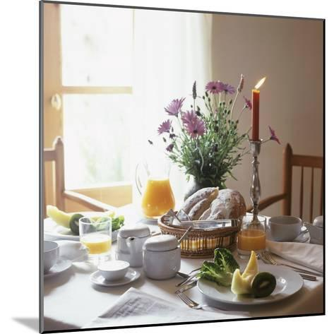 Laid Breakfast Table with Baked Goods, Juice and Fruit--Mounted Photographic Print