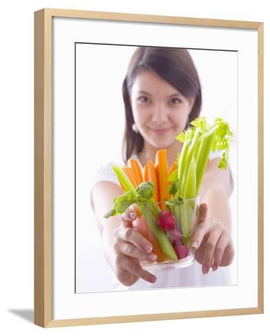 Girl Holding a Bowl of Vegetable Sticks with Radishes--Framed Art Print