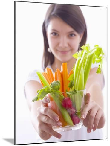 Girl Holding a Bowl of Vegetable Sticks with Radishes--Mounted Photographic Print