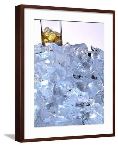 A Whiskey Glass on a Mountain of Ice Cubes-Michael Meisen-Framed Art Print