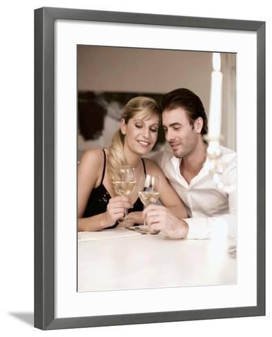 Young Couple Clinking Glasses of White Wine- Sporrer & Skowronek-Framed Art Print