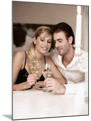 Young Couple Clinking Glasses of White Wine- Sporrer & Skowronek-Mounted Photographic Print