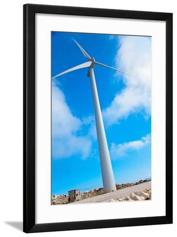 Modern Wind Turbine against Sky-EvanTravels-Framed Art Print