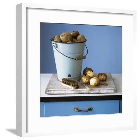 Organic Potatoes in Bucket and on Chopping Board; Brush; Knife-Michael Paul-Framed Art Print