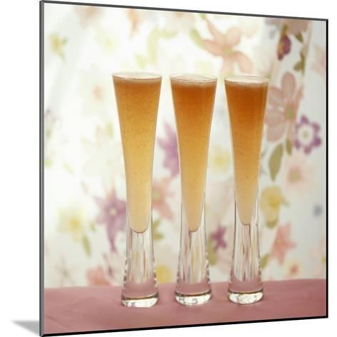 Three Glasses of Bellini (Sparkling Wine with Peach Juice)-Michael Paul-Mounted Photographic Print