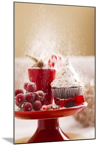 A Christmas Cupcakes in an Icing Sugar Snowstorm-Rogério Voltan-Mounted Photographic Print