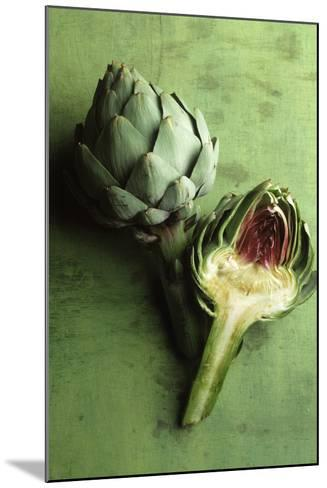 A Whole and a Half Artichoke on Green Background-Studio DHS-Mounted Photographic Print
