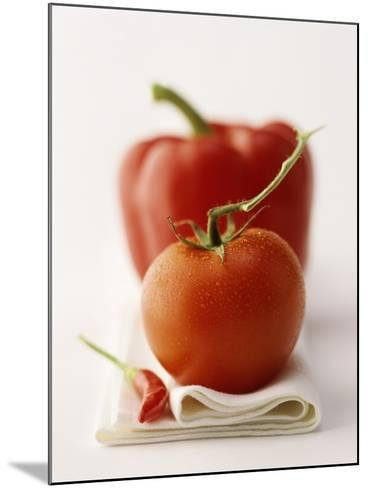 A Still Life Featuring a Red Pepper, a Tomato and a Red Chilli-Michael Wissing-Mounted Photographic Print