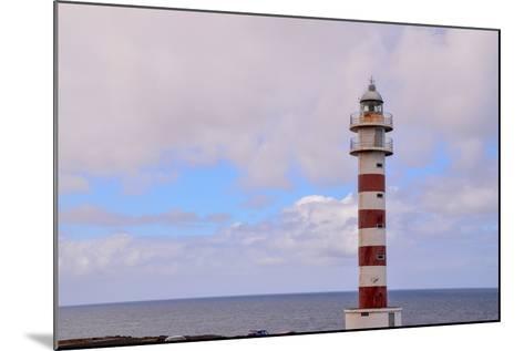 High Lighthouse near the Coast-underworld-Mounted Photographic Print