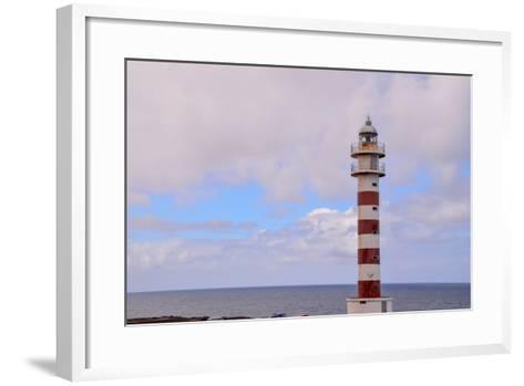 High Lighthouse near the Coast-underworld-Framed Art Print