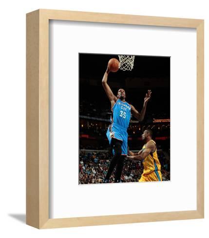 Oklahoma City Thunder v New Orleans Hornets: Kevin Durant and D.J. Mbenga-Chris-Framed Art Print
