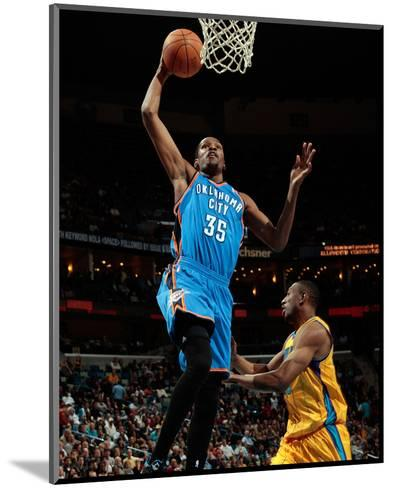 Oklahoma City Thunder v New Orleans Hornets: Kevin Durant and D.J. Mbenga-Chris-Mounted Photo