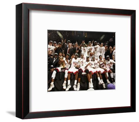 Miami, FL - June 21:  The Miami Heat pose for a team photo after defeating the Oklahoma City Thunde-Issac Baldizon-Framed Art Print