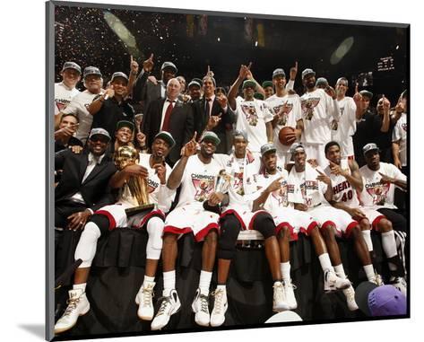 Miami, FL - June 21:  The Miami Heat pose for a team photo after defeating the Oklahoma City Thunde-Issac Baldizon-Mounted Photo