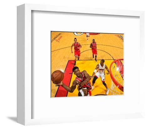 Miami, FL - May 15: Jimmy Butler and LeBron James-Issac Baldizon-Framed Art Print