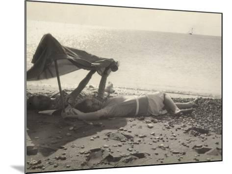 Two Women Lying on the Sea Shore in the Shade of a Towel-Ludovico Pacho-Mounted Photographic Print
