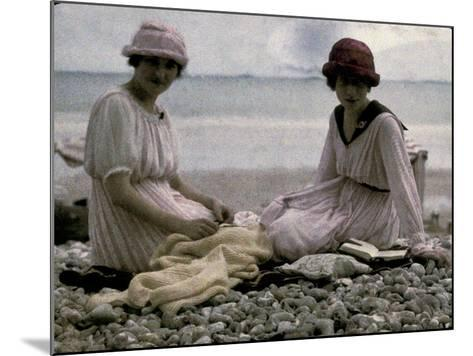 Two Women Sitting on the Beach-Henrie Chouanard-Mounted Photographic Print
