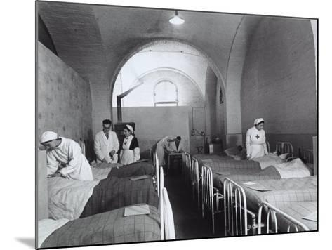 Nurses and Doctors Visiting the Bedridden in the Room of a Hosptial During World War II-A^ Villani-Mounted Photographic Print