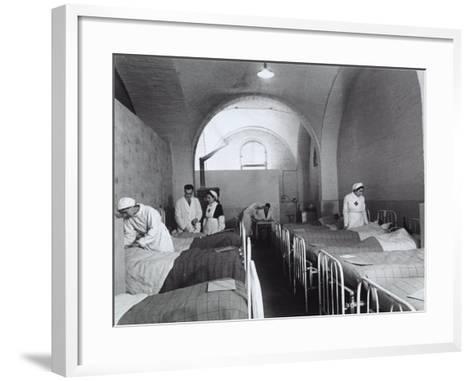 Nurses and Doctors Visiting the Bedridden in the Room of a Hosptial During World War II-A^ Villani-Framed Art Print