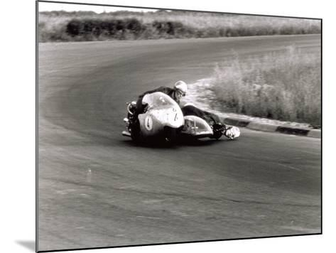 Two Motorcyclists in a Race, on a Two Seater Motorcycle-A^ Villani-Mounted Photographic Print