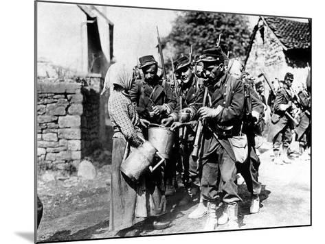 A Group of French Soldiers, They Quench Their Thirst in a Village of the Belgian Border--Mounted Photographic Print