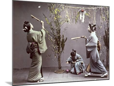 Young Geishas in Traditional Costume Playing 'Hanetuki'--Mounted Photographic Print