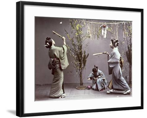 Young Geishas in Traditional Costume Playing 'Hanetuki'--Framed Art Print