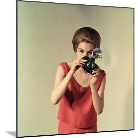Young Woman Taking a Photograph-A^ Villani-Mounted Photographic Print