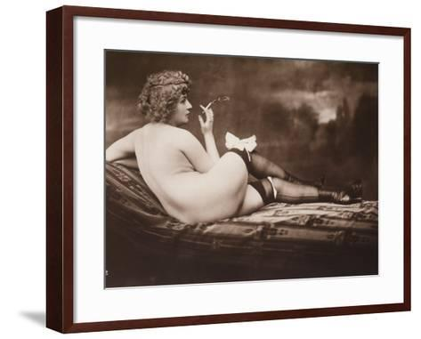 Portrait of a Young Woman Posing Naked, with Her Back Turned, as She Smokes a Cigarette--Framed Art Print