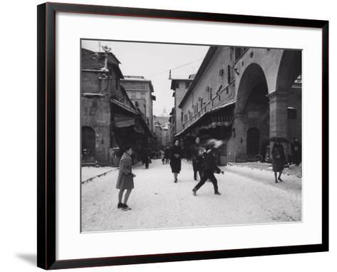 Ponte Vecchio with Snow-Vincenzo Balocchi-Framed Art Print