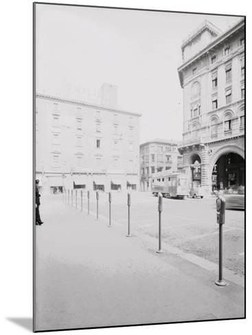 Parking Meters in Piazza Re Enzo in Bologna-A^ Villani-Mounted Photographic Print