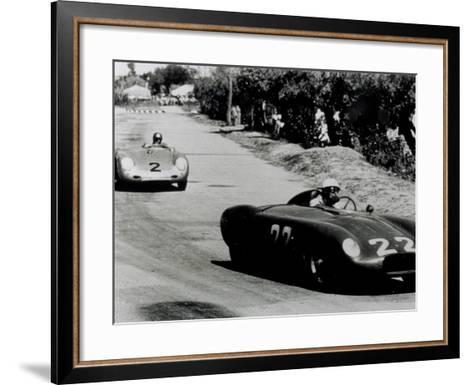 Two Racing Cars Whizzing by on a Road-A^ Villani-Framed Art Print
