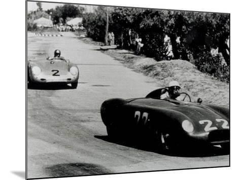 Two Racing Cars Whizzing by on a Road-A^ Villani-Mounted Photographic Print